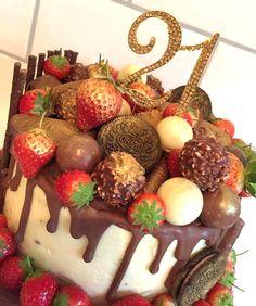 21st birthday. Chocolate drip cake covered with strawberries, forrero rocher, terry's chocolate orange, oreo and lindor