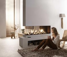 Do you have fire place at your home? If you do not have one, and you are about to build such a fireplace, you have to build 3 sided gas fire place. This fire place is kind of modern fireplace which is built with special concept. Fireplace Stores, Home Fireplace, Fireplace Design, Fireplace Glass, Fireplace Kitchen, Minimalist Fireplace, Minimalist Living, Modern Minimalist, Ethanol Fireplace