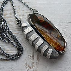 https://www.etsy.com/listing/522297558/baltic-amber-amber-pendant-sterling?ref=shop_home_active_5
