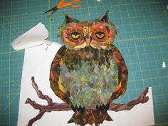 owl made with collaged fabric scraps