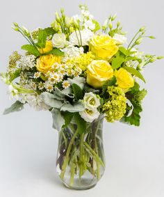 Sun-washed - Bursting with summer, this medium lush, gardeny style arrangement - including roses and lisianthus - consists of all yellows, whites and greens.