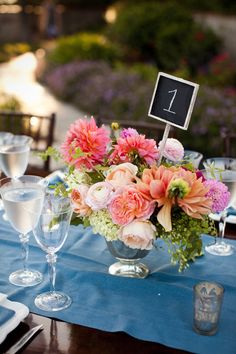 See the blue tablecloth with the pretty flowers (though I want less orange/peach, more pink and cream)?  That's EXACTLY the look I'm going for!!!