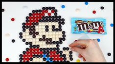 Pixel art of Mario made with M&M Chocolate pieces by Kitslam. Legend Of Zelda, How To Draw Mario, M & M Chocolate, Nintendo, Mosaic Art Projects, Pixel Art Templates, Pixel Art Games, Speed Art, Candy Art