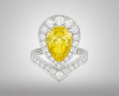 Josephine Aigrette Ring by Chaumet – Platinum ring paved with diamonds and set with a three carat pear-cut yellow diamond.