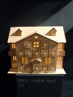 Cute wooden Advent Calendar house at John Lewis for Xmas 2012