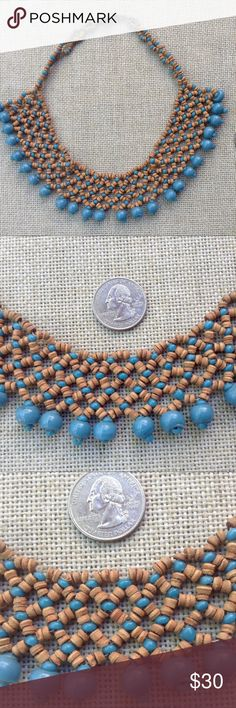 Vintage Woven Beadwork Tribal Necklace /Collar 1970's woven collar necklace. Ethnic, tribal. This type of beadwork is found in all corners of the world. I'd be guessing on the origin of this one. Materials; sky blue glass beads as the fringe hanging from a delicate fishnet weave of smaller blue glass beads alternating with cylindrical brown beads. The brown ones feel like  some kind of clay or seed. Needs some TLC at the clasp as those threads are fraying. I'd bypass them all together and…