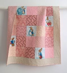 Hand crafted baby girl quilt featuring Beatrix Potter characters.  Dusty rose, pale pink, blue, and beautiful quilting. A little larger than crib size to give baby room to grow.  Kimsquiltingstudio@ Etsy.com. I love, love, love this!! The ultimate baby quilt