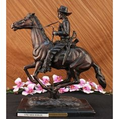 "ON SALE !!! Trooper Of The Plains Bronze By Frederic Remington On Marble Base 19"" Length Art...A Seasoned Cowboy Is Casually Patrolling The Area, When Suddenly Something Catches His Attention. He Pulls Down On His Reins And Brings The Horse About. His Horse'S Head Pulls Back. He Leans Forward And Looks Out Towards The Noise. He Is Dressed In A Shirt,Chaps, Hat And Boots, Giving Him The Look Of A Good Ole Fashioned Sheriff. 100% Bronze And Handmade, This Two-Toned Brown Patina Sculpture Was…"