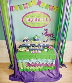 """The """"Dragon scales"""" look on this table covering could be done really easily (i.e. no-sew) with pieces from the remnants section at the fabric store or even tablecloths in different colors from the dollar store."""