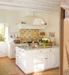 Pretty tile backsplash, chunky island, Dutch doors
