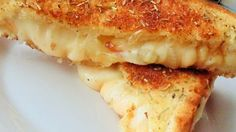 Grilled cheese gets a makeover inspired by white pizza in this quick and easy recipe featuring 3 cheeses, rosemary, and sauteed onions.