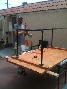patio table with steel pipe legs - couldn't find directions here but you can figure it out from this photo. Great idea to use steel pipe and fittings for legs instead of wood