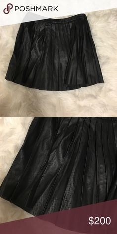 Black Theory Leather Skater skirt 2 Size 2 faux leather skater skirt. Brand is Theory. Perfect condition. Not sure if I really want to let this go....Ask any questions! ✖️No trades. Price is pretty firm. If you are interested in a discount, creating a bundle is the best way 🎀 Theory Skirts