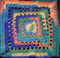 """Dayna's Crochet - Free Patterns 12"""" granny square...it's hard for me to find something that uses variegated yarn."""