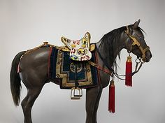 Equestrian Equipment, ca. 1942–46. Tibetan, Derge. The Metropolitan Museum of Art, New York. Purchase, Arthur Ochs Sulzberger and Kenneth and Vivian Lam Gifts; funds from various donors, by exchange; Laird and Kathleen Landmann and Bernice and Jerome Zwanger Gifts; and funds from various donors, 2008 (2008.81a–k) | This work demonstrates that the long tradition of finely made and ornately decorated ceremonial saddles flourished in Tibet until the mid-twentieth century. #horses