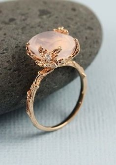 Rose Quartz Ring- Whoa. This would be an AMAZING ring! I'm head over heels in love with it.