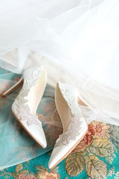 White wedding shoes decorated with a diamante vine pattern by Jenny Packham. Images by The Gibsons #weddingshoes