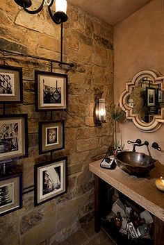 Tuscan style powder room with stone wall.