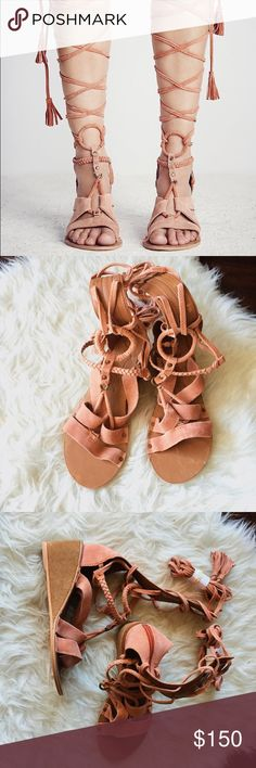 Free People Rust Lace Up Mini Wedge Tall and strappy suede gladiator sandal featuring a mini wedge heel. Laces up the front and zips all the way up the back for an easy on-off. Free People Shoes Wedges