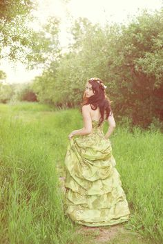 Princess Eva was fascinated by the colour green it was everywhere in grass trees gowns clothing frogs grasshoppers ivy emerald crowns she had a wide variety of green gowns that were different shades of green light green dark green forest green navy green Princess Eva's bedroom was very light lily pad green