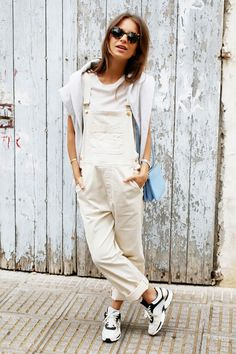 Browse the best summer street style outfit ideas at @stylecaster | blogger @lizzyvdligt in white tee, cream overalls, sneakers