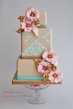 Taupe wedding cake with pink roses and Tiffany blue detail.     ᘡղbᘡ