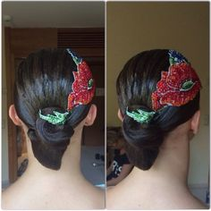 Simple low swirl bun with textured comb over and large, stoned hairpiece. Good hairstyle for standard, but can also be worn for latin. Visit http://ballroomguide.com/comp/hair_make_up.html for more hair and makeup info