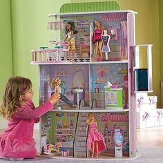 Dollhouse Doll Mall!  Think beyond the dollhouse! Our thrilling doll mall will inspire hours of creative play, with a boutique, restaurant, hair salon, ice cream shop, and more. Includes working elevator, stationary escalator, and 14 charmingly-detailed accessories (including an ATM!).