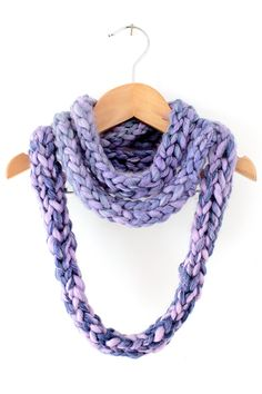 Finger knitting is a great way to introduce kids and adults to knitting. Making a finger knit infinity scarf is a practical, easy first project to try and makes a great gift!