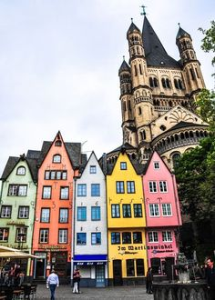 Groß Sankt Martin and Altstadt in Köln (Cologne), Germany. Love the contrast between the jolly houses in the foreground and the architecture and art/embellishments of the Groß Sankt Martin and Altstadt in Cologne Germany church in the background. Dream Vacations, Vacation Spots, Places To Travel, Places To See, Travel Things, Travel Stuff, Wonderful Places, Beautiful Places, Amazing Places