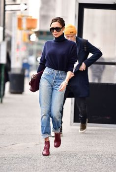 Victoria Beckham in high waisted jeans + turtleneck.