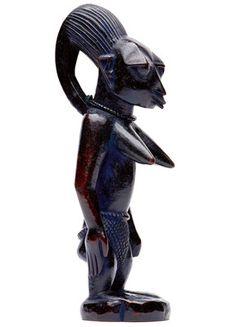 A Yoruba twin figure  Wood - 27 cm Nigeria Ibeji, hair bun prolonged to the middle of the back. Prominent breast. Omu Aran village. Blue...
