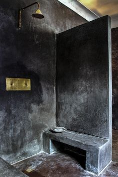This is a little severe for me, but we should have one bathroom look like this just to play on the buildings jailhouse history