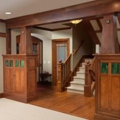 Craftsman style.  Like the stained glass inset.  Also not the usual clear glass panels, prefer the wood.