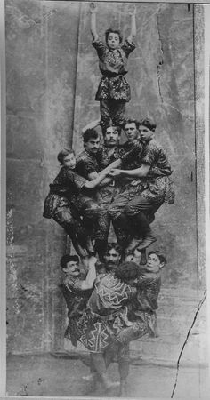 Strong man acrobatic circus act; one man holds up 10 people, c. 1900