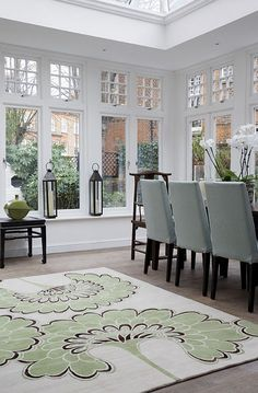 Sunroom dining room. So pretty with amazing windows and soft colors.