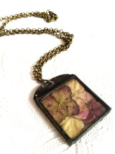 Hydrangea Blossom Necklace, Soldered Glass Flower Pendant, Pressed Hydrangea Necklace, Dried Flower Jewelry, Hydrangea Collage Necklace 35.00, via Etsy.