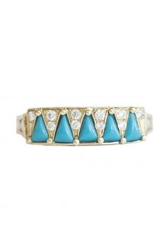 Think turquoise can't be sophisticated enough for forever? Think again. Designer Caitlin Mociun turns a set of tiny triangles on a simple gold band into an eternity-worthy ring with geometric flair. #refinery29 http://www.refinery29.com/rings-for-the-special-day#slide-6