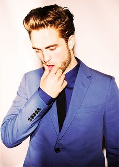 This man should just wear blue suits every day for forever.