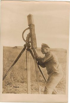 Rocket Man, via Flickr. A German soldier prepares what appears to be a signal rocket for launch. WWI.