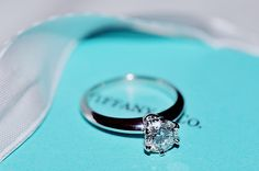 Tiffany engagement ring.. solitaire, white gold(or platinum) setting, and round diamond. A girl can dream.. ;)