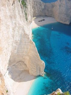 Zakynthos, Greece. dreaming of taking a boat out and chilling on that little beach