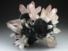 Amethystine Quartz included with Hematite at the terminations to give the reddish tinge on Hematite rosettes from Jinlong Hill, China