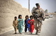 Children in Afghanistan have a new friend - Walking Tall by United States Marine Corps Official Page, via Flickr