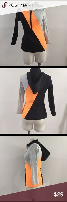 BRAND NEW, NEVER WORN: BEBE sport hooded jacket Get your hands on this amazing deal for a color blocked, hooded workout zip up jacket. Tri-color in black, orange and grey with hood and zipper pockets. Made of stretchy spandex material. Great for your next workout or running errands on the weekends! bebe Jackets & Coats Utility Jackets