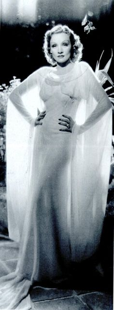 Marlene Dietrich giving us everything in this gown and sheer cape.