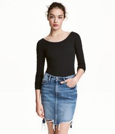 Black. Long-sleeved jersey bodysuit with a low-cut neckline at back and snap fasteners at gusset.