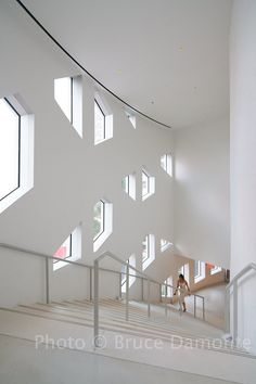 OMA has completed the Faena District, a trio of buildings - an arts center, a retail bazaar and car park - in Miami Beach #cultural #centre #white #staircase