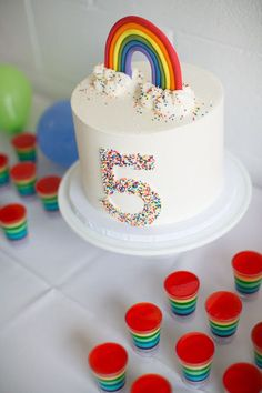 Rainbow birthday cake! Love this modern rainbow birthday party. More