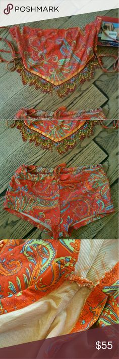 Two-piece bikini paisley print Two-piece bikini paisley print Two-piece paisley print bikini underwear/shorts large  and top is one size. This color is beautiful for summer great for pictures great with some tan. coverstyle Shorts